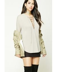 Forever 21 - Natural Lace-up Dolphin Hem Top - Lyst