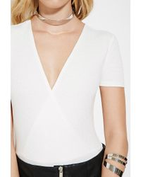 Forever 21 - White Ribbed Surplice Bodysuit - Lyst