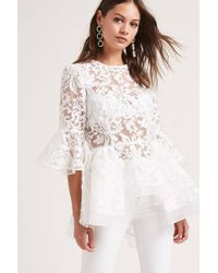 df8adc1eab489 Lyst - Forever 21 Embroidered High-low Top in White