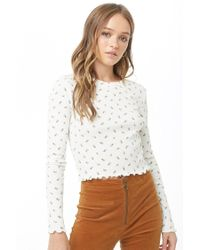 b2ebf8fd0b10a Lyst - Forever 21 Floral Ribbed Crop Top in White