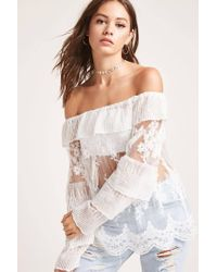 4eb583145dab68 Lyst - Forever 21 Sheer Lace Off-the-shoulder Top in White