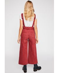 8b7b24694f1 Lyst - Free People Belted Twill Jumpsuit By We The Free in Red