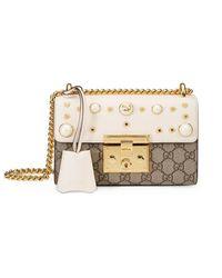 fa839ab8bbb5 Lyst - Gucci Padlock Studded Gg Supreme Shoulder Bag in Natural