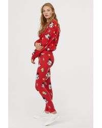 4d40a9f243313 Lyst - H&M Patterned leggings in Red