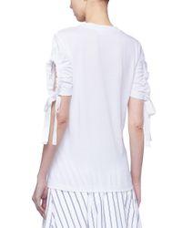 Victoria, Victoria Beckham - White Drawstring Ruched Cutout Cuff T-shirt - Lyst
