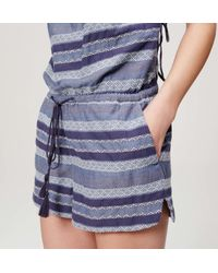 LOFT - Blue Beach Striped Criss Cross Romper - Lyst