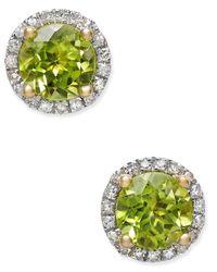 Macy's | Green Peridot (1-3/4 Ct. T.w.) And Diamond (1/6 Ct. T.w.) Halo Stud Earrings In 14k Gold | Lyst