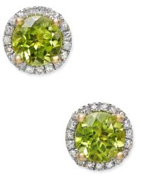 Macy's | Green Peridot (1-3/4 Ct. T.w.) And Diamond (1/6 Ct. T.w.) Halo Stud Earrings In 14k Gold | Lyst
