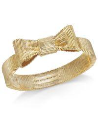 Kate Spade - Metallic Gold-tone Engraved Bow Bangle Bracelet - Lyst