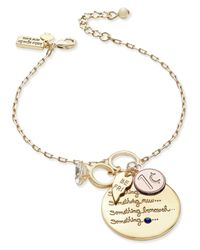 kate spade new york | Metallic Gold-tone Tie-the-knot Charm Bracelet | Lyst