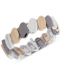 Nine West - Metallic Tri-tone Oval Disk Stretch Bracelet - Lyst
