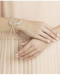 Swarovski - Multicolor Two-tone Clear & Pink Pavé Knot Cuff Bracelet - Lyst