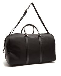 Prada - Black Saffiano Leather-trimmed Nylon Holdall for Men - Lyst