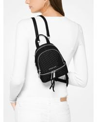 Michael Kors - Black Rhea Mini Perforated Leather Backpack - Lyst