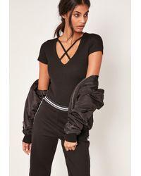 Missguided - Black Harness Neck Short Sleeve Bodysuit - Lyst