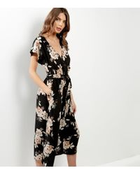 29640dd9819c New Look Black Floral Print Tie Waist Culotte Jumpsuit in Black - Lyst