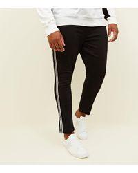 a4fac2fcd9cd New Look Plus Size Black Monochrome Side Stripe Skinny Jeans in ...