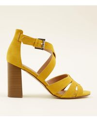 a7a6f4fb691 New Look Mustard Suedette Cross Strap Block Heel Sandals in Yellow ...