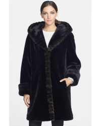 Gallery - Black Hooded Faux Fur Walking Coat - Lyst