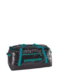 Patagonia | Black Hole Water Repellent Duffel Bag for Men | Lyst