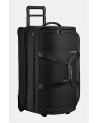 Briggs & Riley | Black 'medium Baseline' Rolling Duffel Bag for Men | Lyst