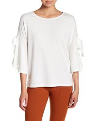 Pleione - White Bow Bell Sleeve Blouse - Lyst