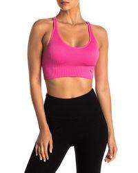 PUMA - Pink Mirrored Crisscross Sports Bra - Lyst