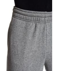 PUMA | Gray Cuffed Sweatpant for Men | Lyst