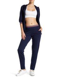 Nanette Lepore | Blue Laser Cut Track Ankle Pant | Lyst