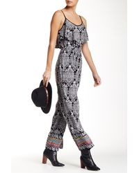 Angie - Blue V-neck Ruffle Jumpsuit - Lyst