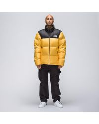 6ad05ebc27 ... black label 1992 nuptse jacket yellow 51007 d7303 australia the north  face. mens novelty nuptse jacket in yellow 94922 b9776 ...
