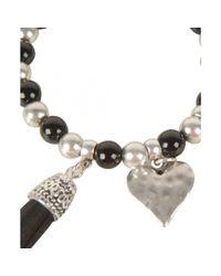 Olia Jewellery - Black Loretta Stretch Tassle Bracelet - Lyst