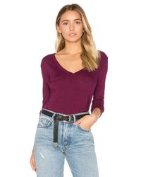 Bobi | Black Light Weight Jersey Front Pocket Long Sleeve Top | Lyst