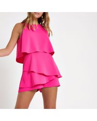 668cf9429c18 River Island Petite Bright Tiered Sleeveless Playsuit in Pink - Lyst