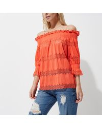 9c39f65701f6d River Island Petite Coral Lace Shirred Bardot Top in Orange - Lyst