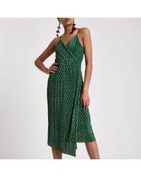 77e54e5e23f3 River Island Green Plisse Spot Wrap Midi Slip Dress in Green - Lyst