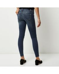 River Island - Mid Blue Wash Ripped Molly Jeggings - Lyst