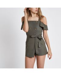 815975ded9 River Island Khaki Bardot Button Playsuit in Natural - Lyst