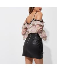 River Island - Black Fringed Buckle Faux Leather Mini Skirt - Lyst