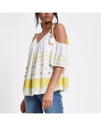 91e72321cd84ee Lyst - River Island Yellow Embellished Tassel Cold Shoulder Top in ...