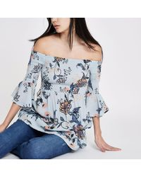 31f98cb55c268 Lyst - River Island Floral Shirred Bardot Bell Sleeve Top in Blue