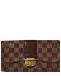 29b9f06793cc3 Lyst - Louis Vuitton Damier Ebene Canvas Sistina Wallet in Brown