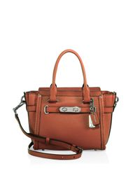 COACH | Brown Swagger Small Pebbled Leather Satchel | Lyst