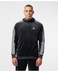 new style 34076 7eec3 adidas Originals. Men s Black Cozy 1 2 Zip Overhead Hoodie
