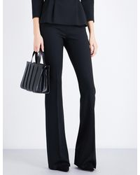Max Mara | Black Baita Flared Stretch-wool Trousers | Lyst