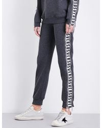 Versus  - Blue Logo-tape Relaxed-fit Mid-rise Jersey Jogging Bottoms for Men - Lyst