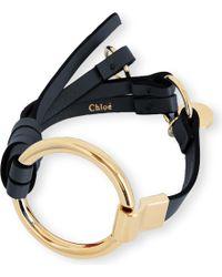Chloé - Black Leather And Brass Circle Bracelet - Lyst