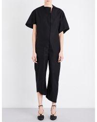 Phoebe English | Black Asymmetric Cotton-poplin Jumpsuit | Lyst
