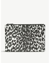 37f401dc6964 Givenchy Iconic Print Pouch 29cm in Black - Lyst