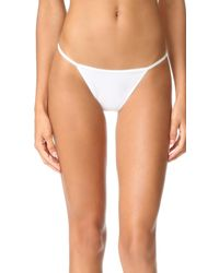 b5990fe58b Calvin Klein Sleek String Bikini Panties in White - Lyst